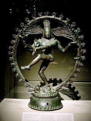 Bronze Chola statue depicting Shiva dancing as...