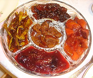 Five varieties of fruit preserves (clockwise f...