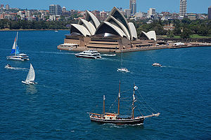 Sydney Opera House with a tall ship in the for...
