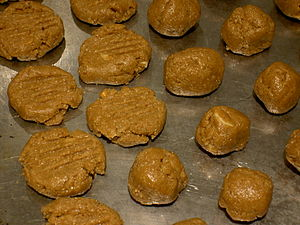 Peanut butter cookies, uncooked on the baking ...