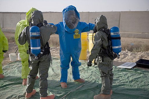A U.S. Marine goes through a decontamination station during an anti-terrorist force protection drill conducted by the Marine Air Group (MAG) 26 chemical, biological, radiological and nuclear department 090519-M-CY203-041