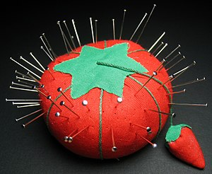 A pincushion (sewing), with pins. The small