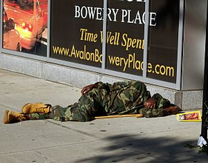 A man sleeping on the street of The Bowery in ...