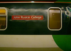 The 'John Ruskin College' nameplate on 319011