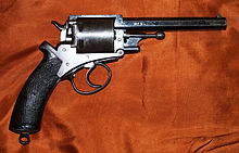 Long-barreled revolver with a black handle