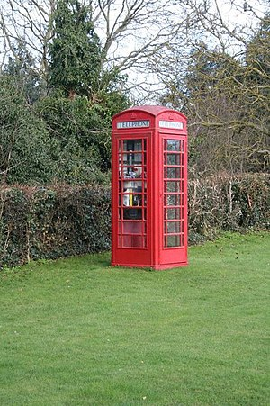 English: Phone box in the garden When I walked...