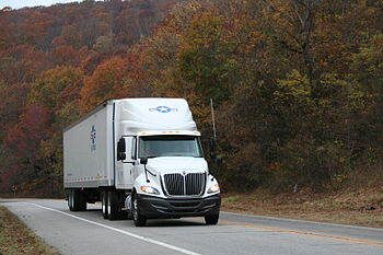 English: USA Truck driving down the road