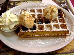 Waffle with ice cream and whipped cream (IJssa...