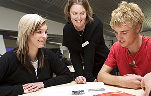 English: Students working with a teacher at Al...