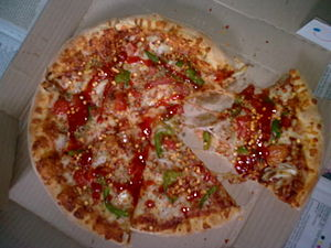 English: Dominos Pizza delivered to our doorwa...
