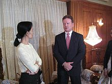 U.S. Senator Jim Webb visiting Suu Kyi in 2009. Webb negotiated the release of John Yettaw, the man who trespassed in Suu Kyi's home, resulting in her arrest and conviction with three years' hard labour.