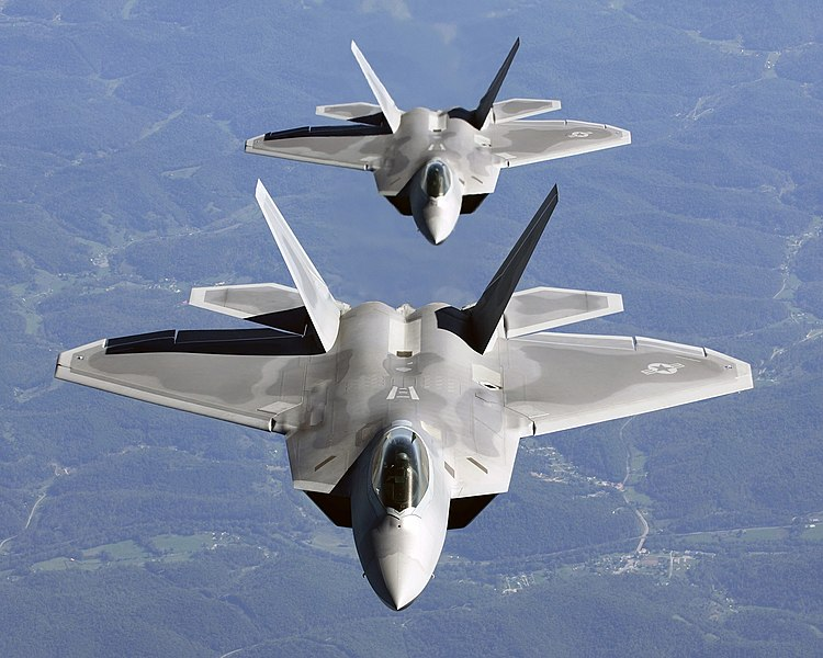 Two F-22A Raptor in column flight - (Noise reduced).jpg