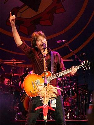 American rock musician John Fogerty, performin...