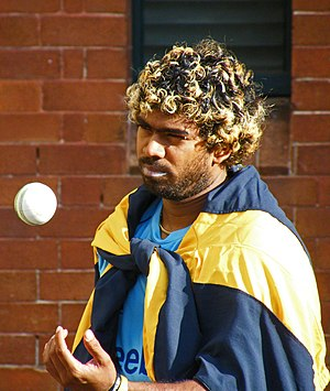 Sri Lankan cricketer Lasith Malinga tosses a c...