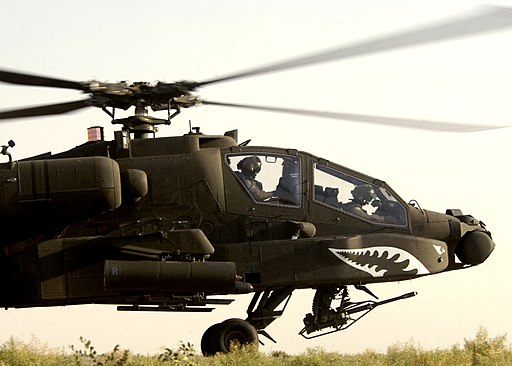 US Navy 050803-N-5027S-174 A U.S. Army AH-64 Apache helicopter prepares to takeoff for a mission in Iraq