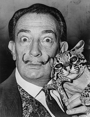 Salvador Dali with ocelot and cane.