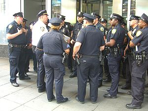 English: New York City Police officers being d...