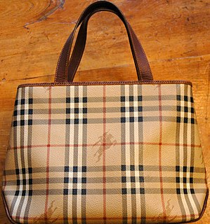 A ladies' Burberry handbag in the company's tr...