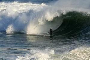 A big wave is breaking in Santa Cruz, Californ...