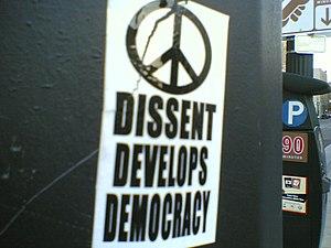 "Sticker advocating dissent: ""dissent deve..."
