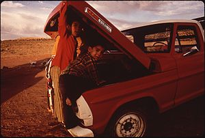 NAVAJO CHILDREN EXAMINE THEIR FAMILY PICK-UP T...
