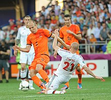 Dutch Star Football Players Arjen Robben And Robin Van Persie During A Game With The Netherlands National Football Team Against Denmark National Football