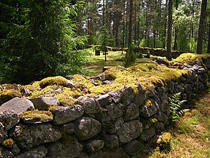 The stone fence of the old Vierevi cemetery of...