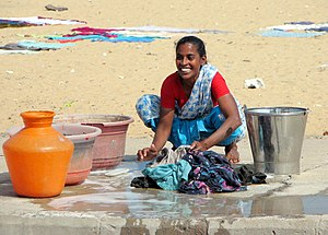 English: Woman doing laundry in Chennai, India...
