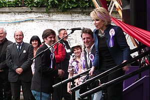 Joan Rivers prepares to cut the ribbon and ope...
