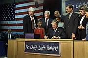 Bush signs the No Child Left Behind Act into law.