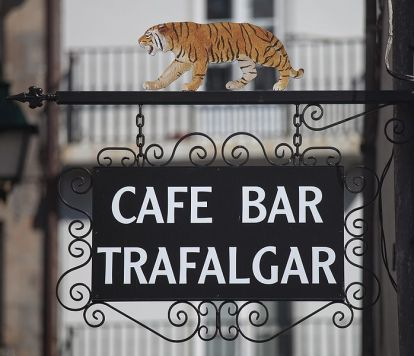 Cafe Bar sign with tiger on top
