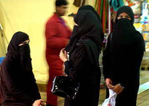 These four Muslim women patiently wait for the...
