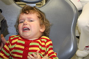 fearfull and crying child before dental treatment