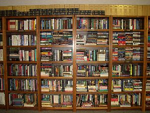 English: Books on shelves at UWI Library, Trin...