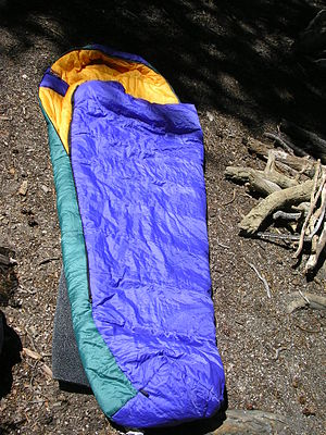 A sleeping bag. A corner of the black sleeping...