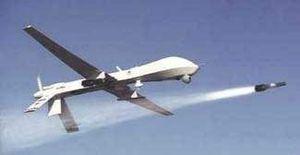 Armed Predator drone firing Hellfire missile