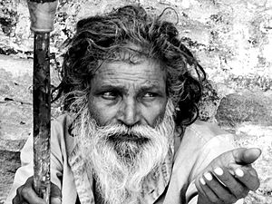 English: A man begging on the streets of Harid...