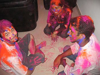 English: Colourful people after Holi celebration.