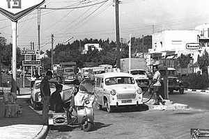 English: Fueling vehicles at the gas station o...