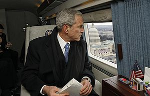 Former President George W. Bush looks out over...