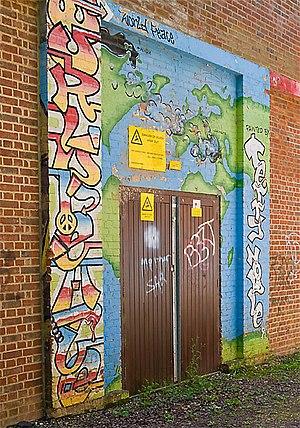 English: Graffiti on door of Butts Ash electri...