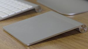 A picture of the Magic Trackpad next to the Ap...