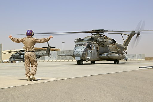 U.S. Marine Corps Sgt. Joshua Morrison, a fuel chief with Marine Wing Support Squadron (MWSS) 274, gives pilots the all-clear signal after refueling a CH-53E Super Stallion helicopter at a forward arming 140903-M-EN264-276