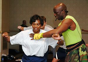 English: Fitness trainer Billy Blanks shows a ...