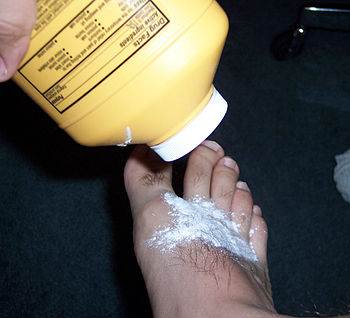 Body powder being applied to foot