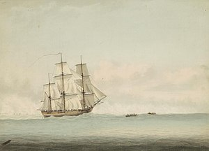 A three-masted wooden ship cresting an ocean swell beneath a cloudy sky. Two small boats tow the ship forward.
