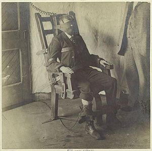 Man in an electric chair.