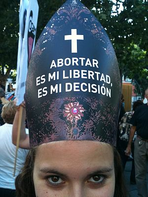 Female demonstrator wearing a hat in Madrid. I...