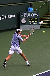 Andy Murray hits a backhand in his second roun...