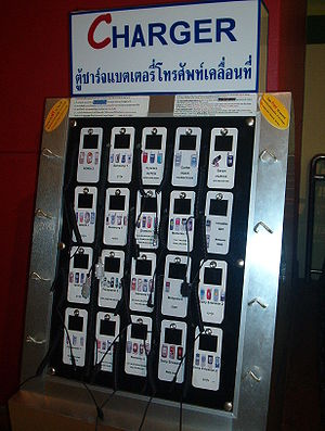 Pay-per-charge phone charger array in a Thai s...